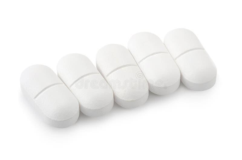 在白色背景隔绝的扑热息痛药物 库存照片