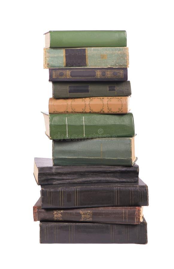 在白色背景隔绝的旧书堆 库存图片