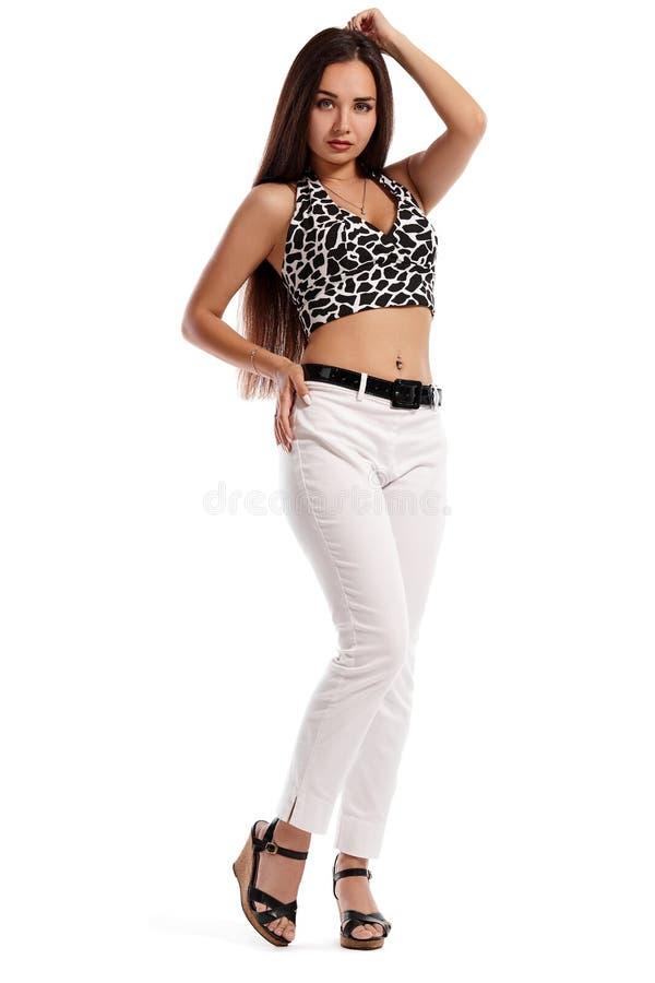 在白色背景隔绝的时装模特儿女孩的全长画象 免版税库存照片
