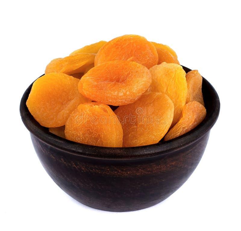 在白色背景隔绝的杏干 库存图片