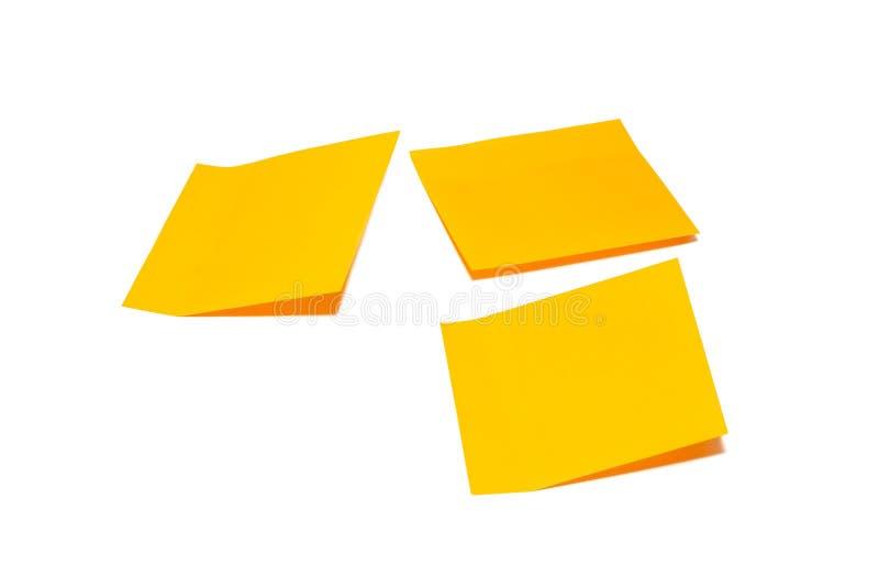 在白色背景隔绝的橙色棍子笔记 免版税图库摄影