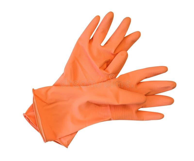 在白色背景隔绝的橙色橡胶手套,裁减路线 图库摄影