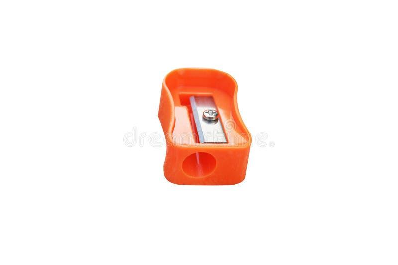 在白色背景隔绝的橙色铅笔刀 库存图片