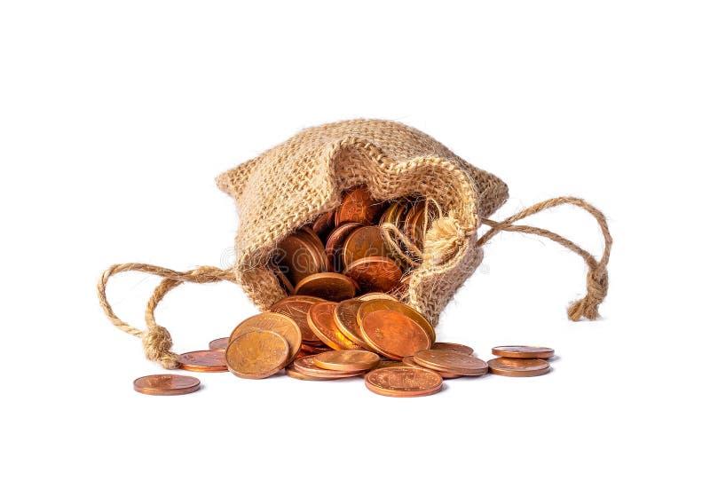 在白色背景隔绝的欧元硬币袋子 免版税库存图片