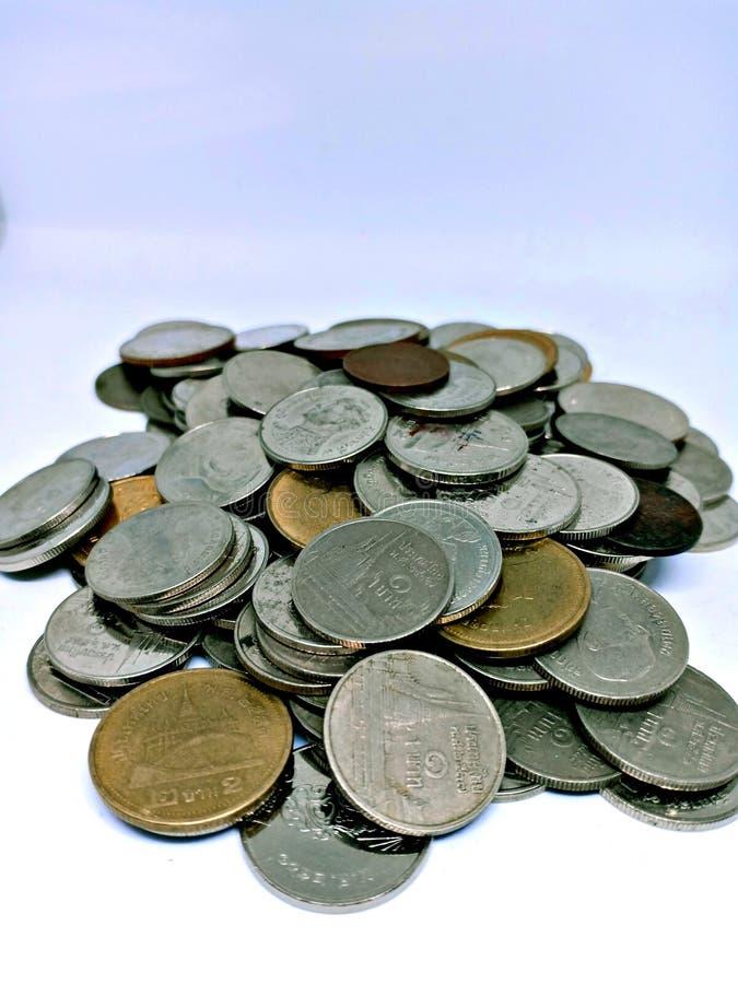 在白色背景隔绝的泰国浴硬币 库存照片