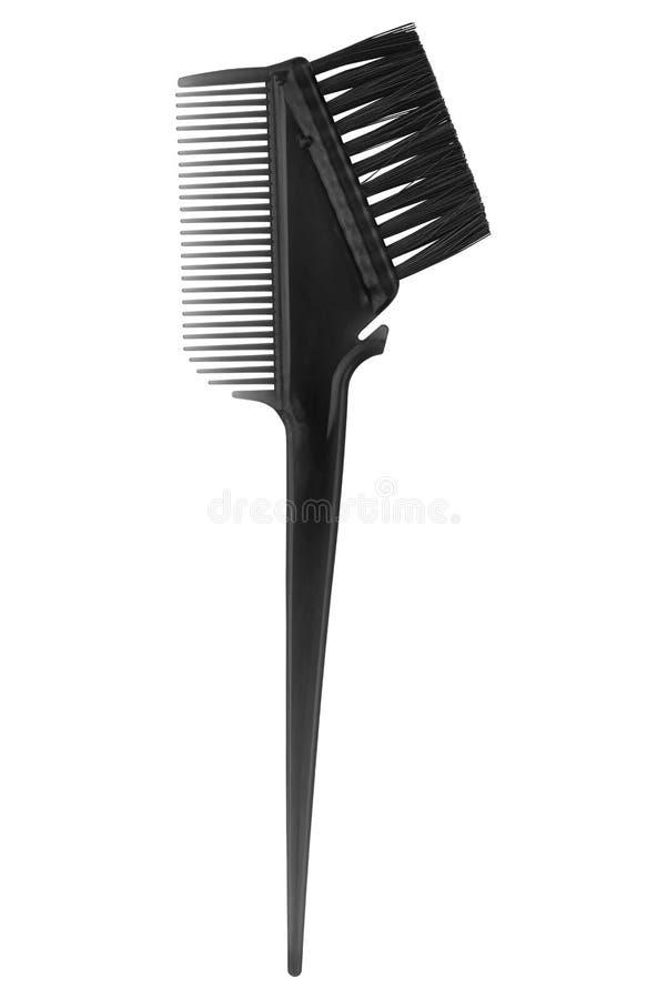在白色背景隔绝的洗染的头发黑刷子 库存图片