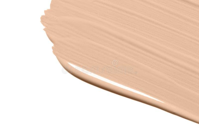 在白色背景隔绝的液体基础纹理污迹 构成产品样片 图库摄影