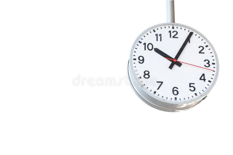 在白色背景隔绝的火车站的时钟 免版税库存图片