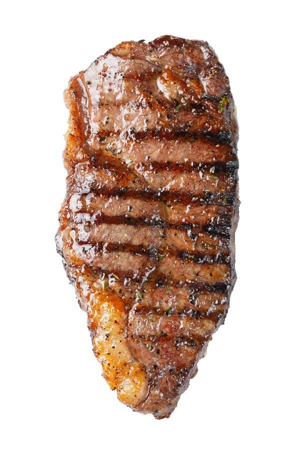 在白色背景隔绝的烤使有大理石花纹的牛排striploin,顶视图 查出 图库摄影