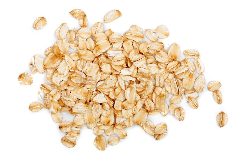 在白色背景隔绝的燕麦剥落 顶视图 库存照片