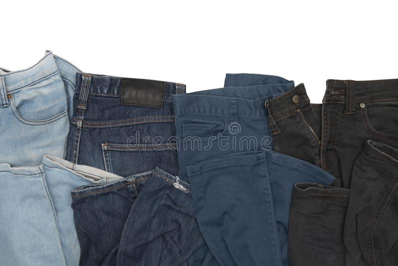 在白色背景隔绝的牛仔裤收藏 库存照片