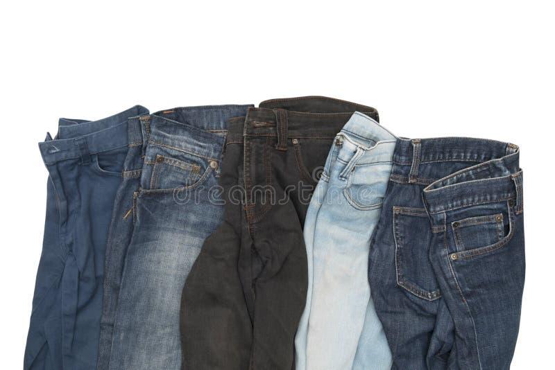 在白色背景隔绝的牛仔裤收藏 库存图片