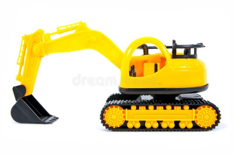 在白色背景隔绝的玩具推土机 被隔绝的推土机玩具 被隔绝的拖拉机玩具 库存图片