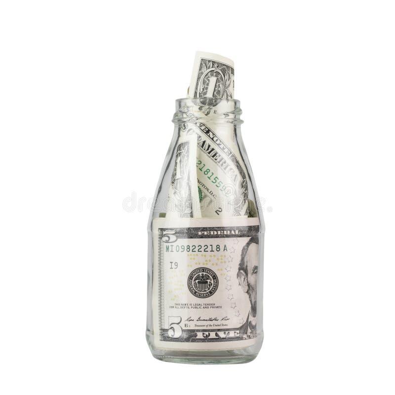 在白色背景隔绝的玻璃瓶子的美金 免版税库存照片