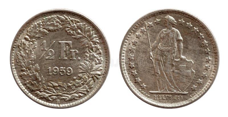在白色背景隔绝的瑞士瑞士硬币半法郎1959银 库存照片