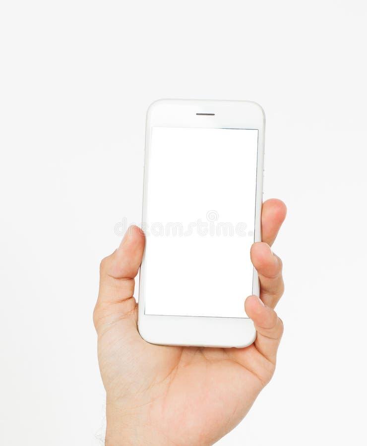 在白色背景隔绝的男性手举行黑屏电话,裁减路线里面,新的流动应用程序 顶视图,假装  库存照片
