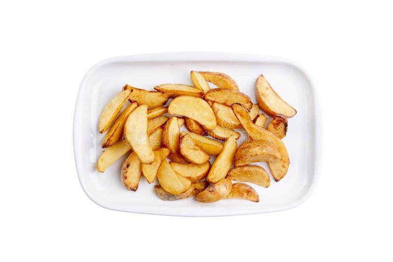 在白色背景隔绝的白色板材的土豆楔子 热的快餐 顶视图菜单卡片的食物图象,网络设计 免版税库存图片