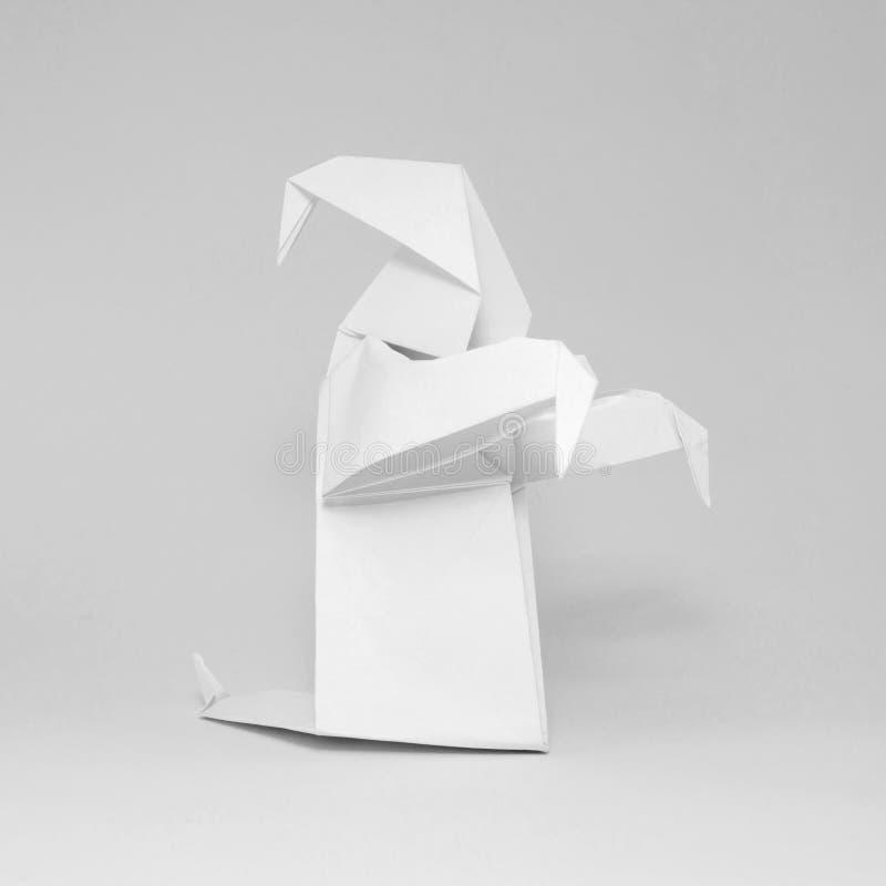在白色背景隔绝的白色origami鬼魂照片  库存照片