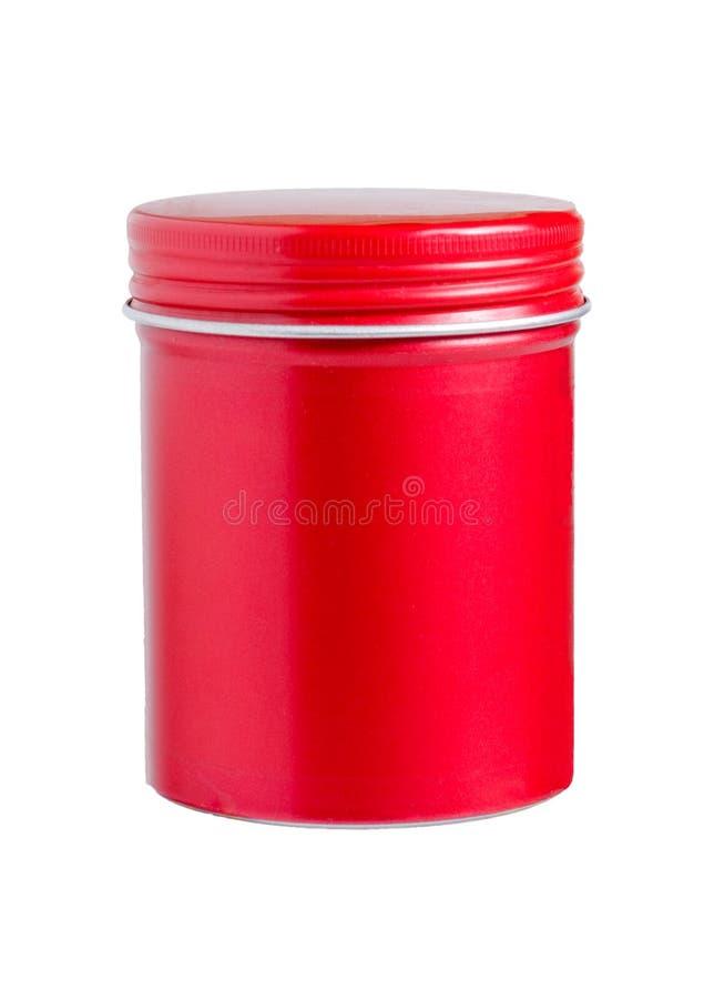 在白色背景隔绝的空白红色铝圆柱形容器 包装头发化妆用品的 图库摄影