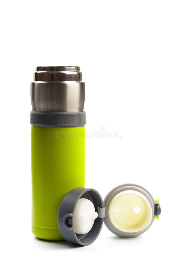 在白色背景隔绝的空的不锈的热水瓶特写镜头 演播室摄影-图象 免版税图库摄影