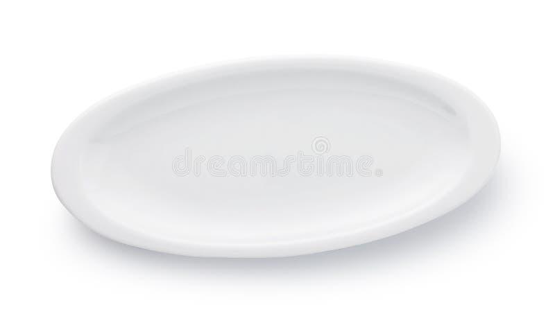 在白色背景隔绝的空的卵形陶瓷板材 库存照片