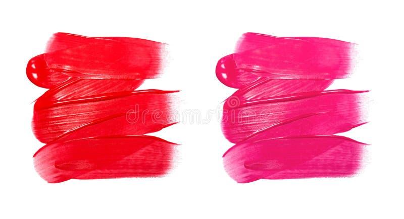 在白色背景隔绝的红色唇膏污点照片  库存照片