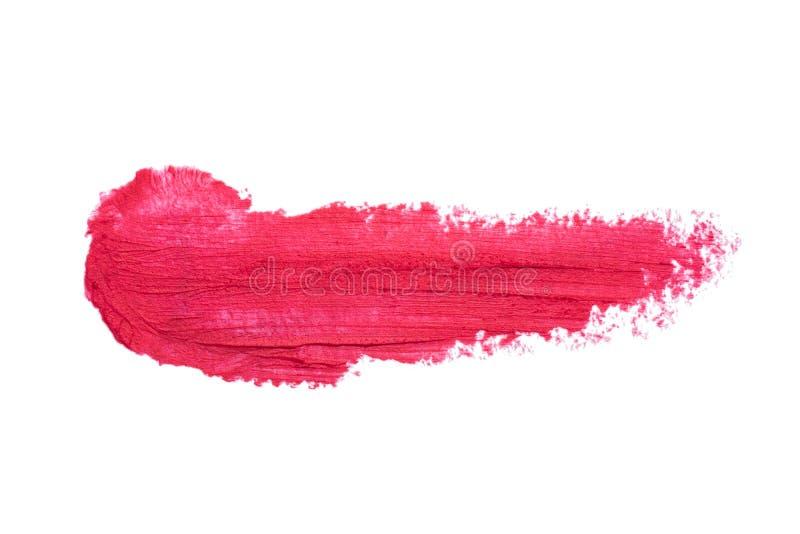 在白色背景隔绝的红色唇膏污点 被弄脏的构成 库存照片