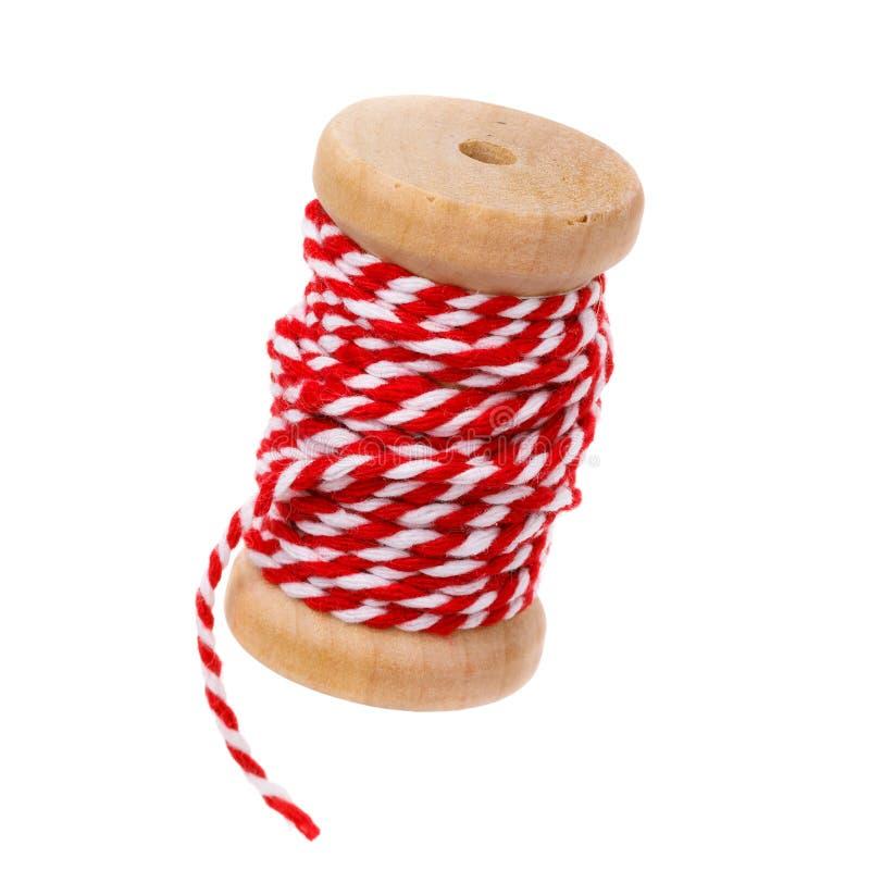 在白色背景隔绝的红色螺纹卷轴 免版税库存图片
