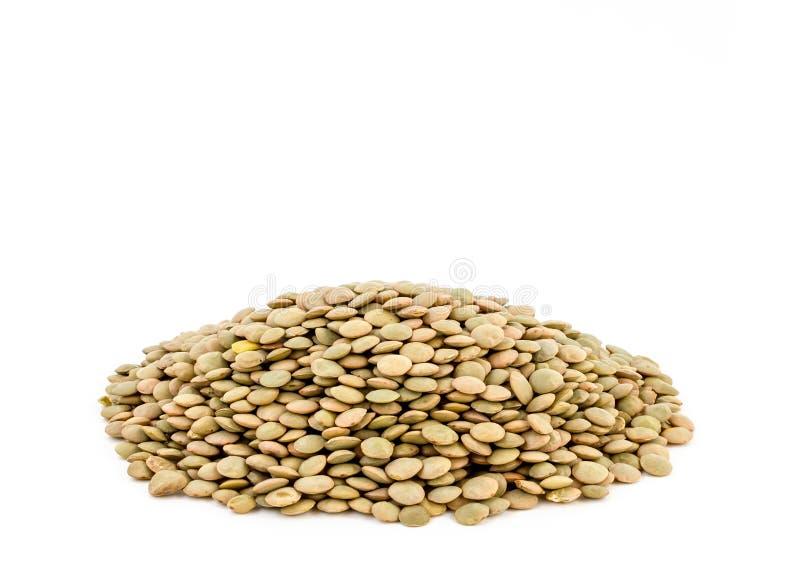 在白色背景隔绝的绿色扁豆堆 免版税图库摄影