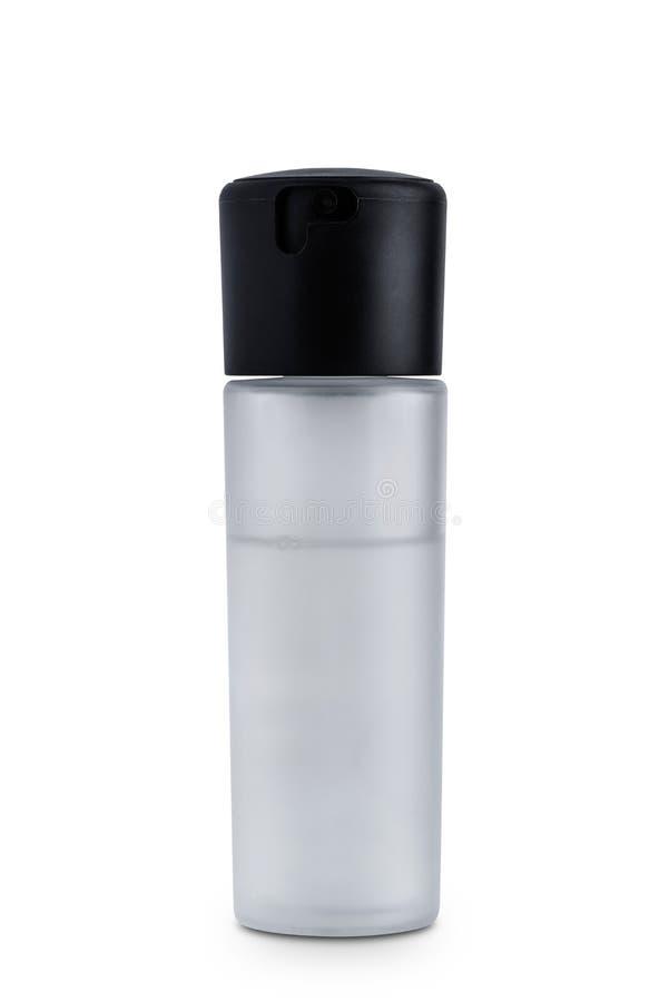 在白色背景隔绝的美丽的透明度瓶的妇女的香水 图库摄影
