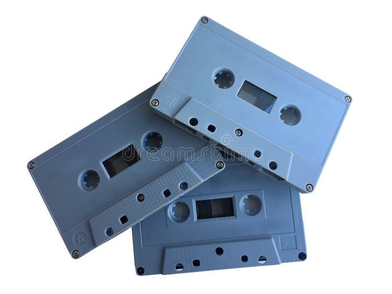 在白色背景隔绝的老经典录音磁带卡式磁带重叠 库存照片