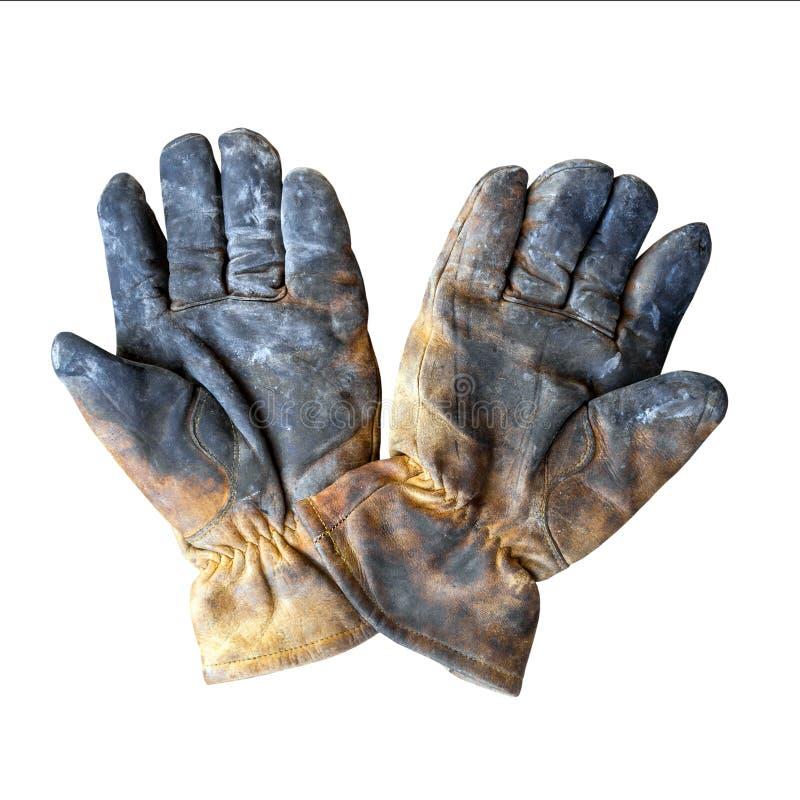 在白色背景隔绝的老肮脏的皮革工作手套 库存图片