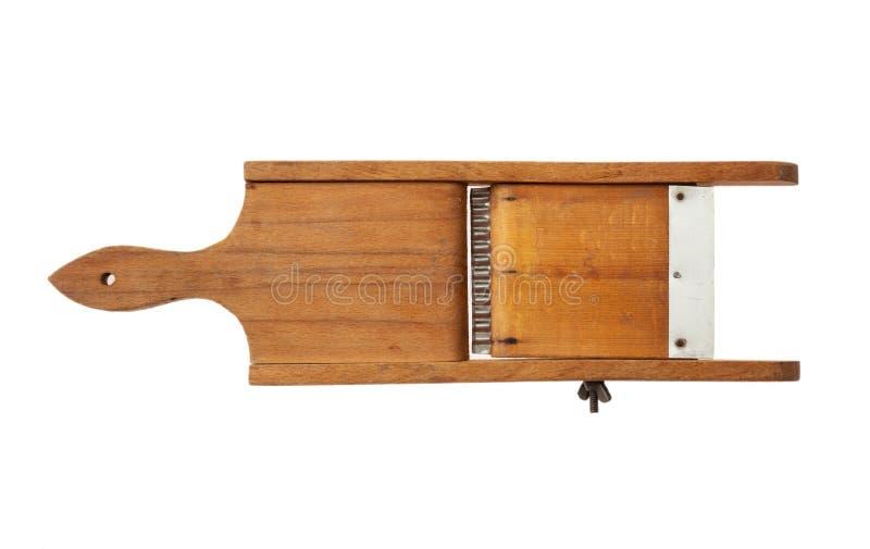 在白色背景隔绝的葡萄酒木切片机 库存图片