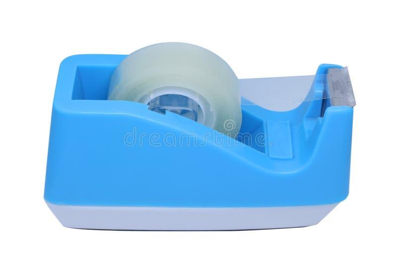 在白色背景隔绝的蓝色塑料磁带分配器 免版税库存照片