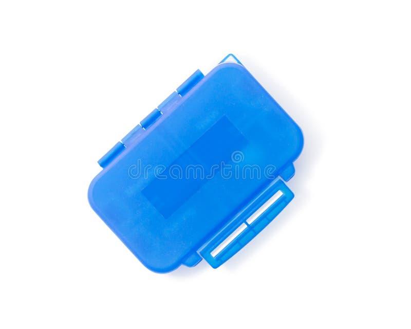 在白色背景隔绝的蓝色塑料药片组织者 免版税库存照片