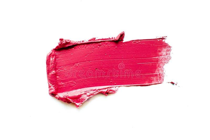 在白色背景隔绝的被弄脏的红色唇膏 免版税库存图片