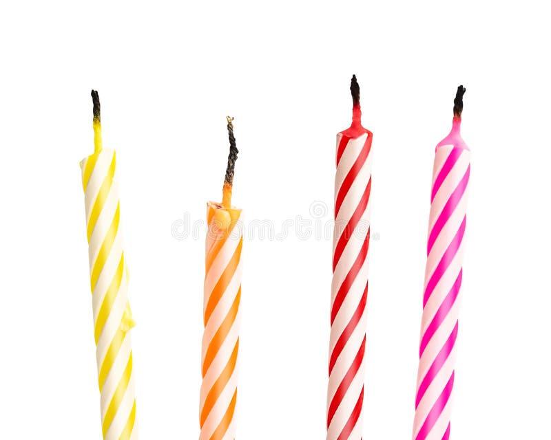 在白色背景隔绝的被烧的生日蜡烛 五颜六色的收藏 r 免版税图库摄影