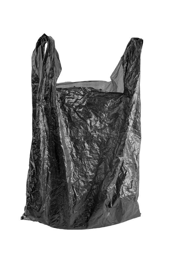 在白色背景隔绝的起皱纹的空的垃圾袋 使用的黑被弄皱的聚乙烯小包 库存图片