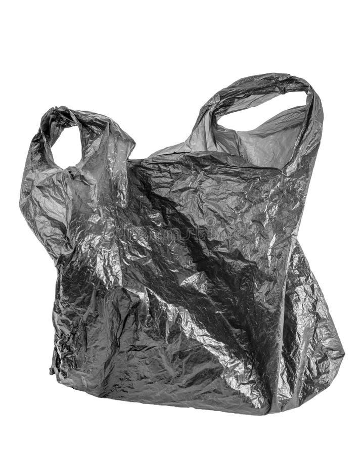 在白色背景隔绝的起皱纹的空的垃圾袋 使用的黑被弄皱的聚乙稀小包 免版税库存图片