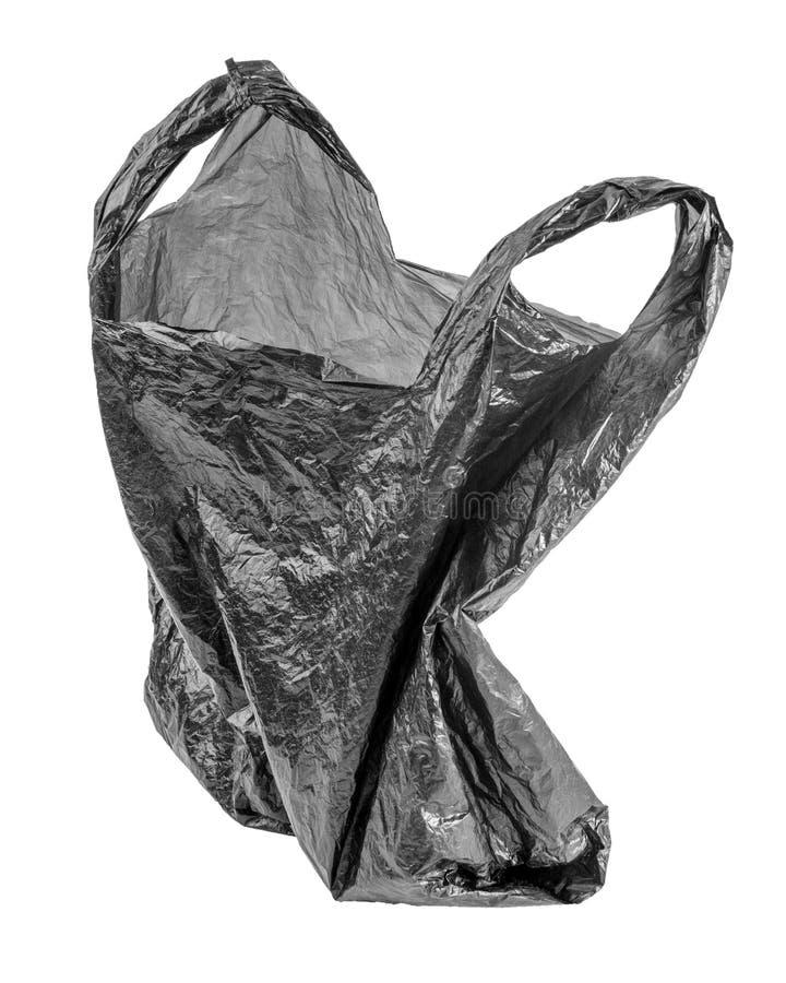 在白色背景隔绝的起皱纹的空的垃圾袋 老黑被弄皱的聚乙烯组装 库存照片