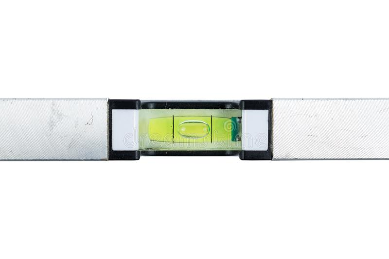 在白色背景隔绝的银色水平仪 建筑室内漆滚筒工具墙壁 金属小精神杠杆 修理工具 免版税图库摄影