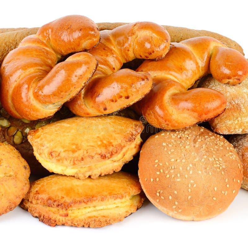 在白色背景隔绝的面包和面包店产品 库存照片