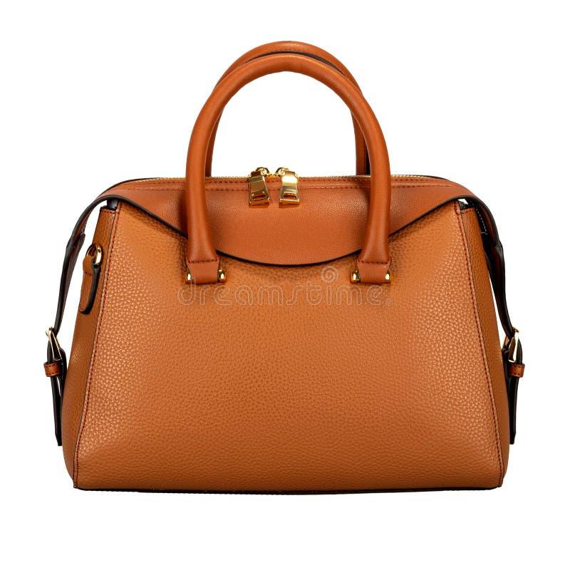 在白色背景隔绝的饱和的橙色女性皮包 免版税图库摄影