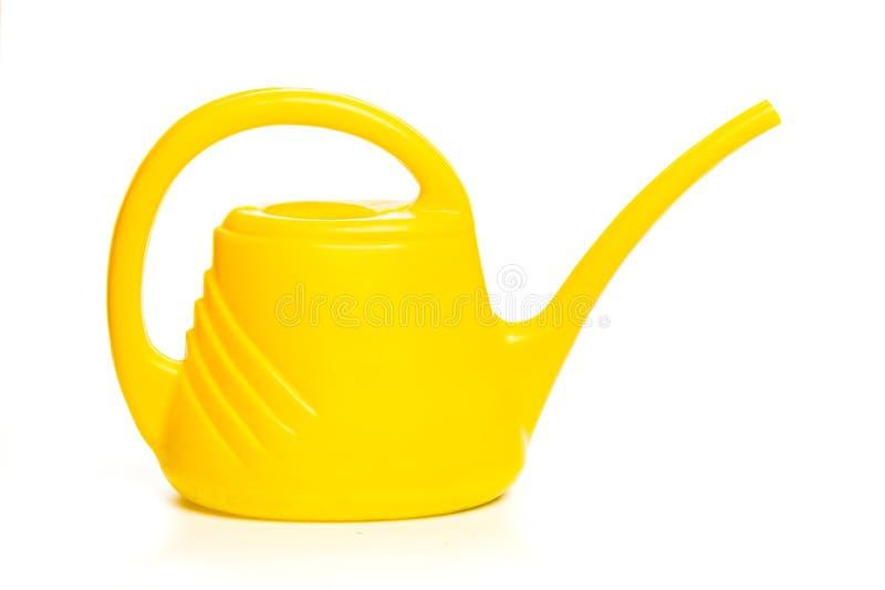 在白色背景隔绝的黄色喷壶 免版税库存照片