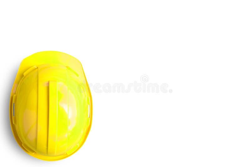 在白色背景隔绝的黄色安全工程师盔甲 免版税图库摄影