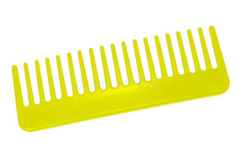 在白色背景隔绝的黄色梳子 库存照片