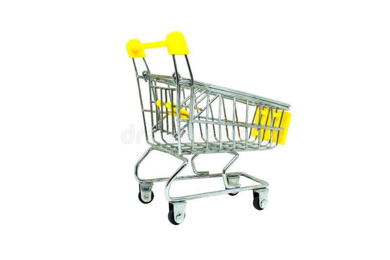 在白色背景隔绝的黄色购物车 选择聚焦 免版税库存照片