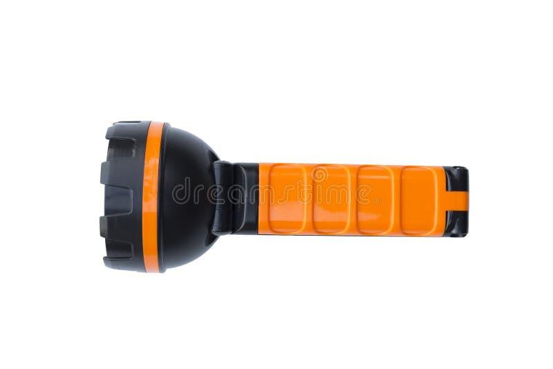 在白色背景隔绝的黑橙色手电 库存图片