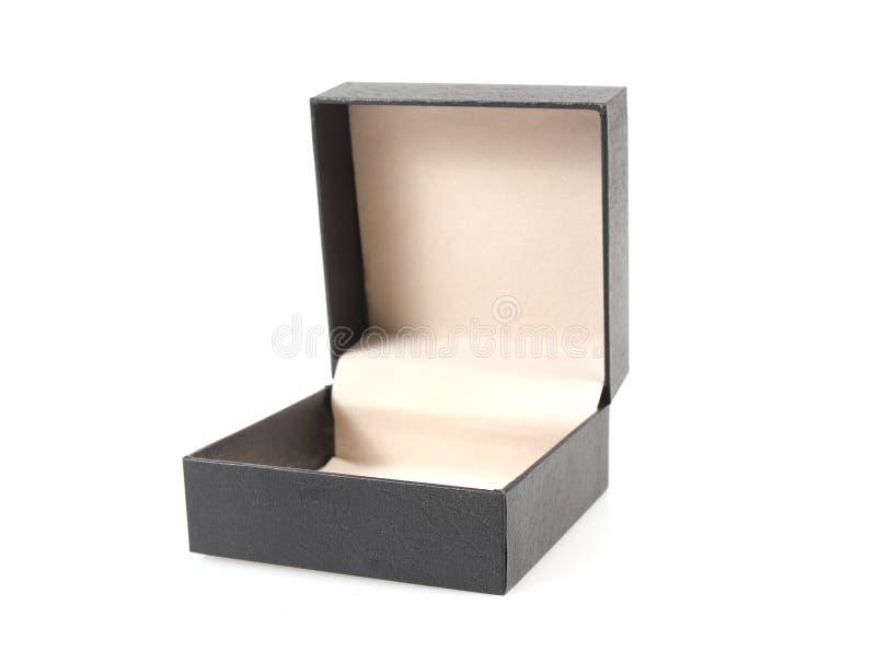在白色背景隔绝的黑色开放礼物盒 库存照片