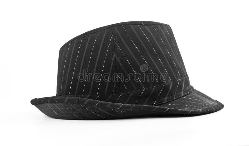 在白色背景隔绝的黑镶边帽子,侧视图 免版税库存照片